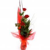 3 red roses arranged with a vase